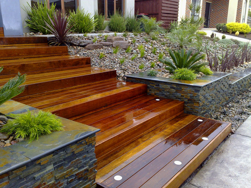Planter Boxes Along Fence With Bench
